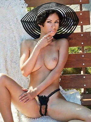 """With the bright sun shine, Pammie Lee sensually strips off her deep elegant black lingerie, hot sexy stockings and poses with so much ease outsi"